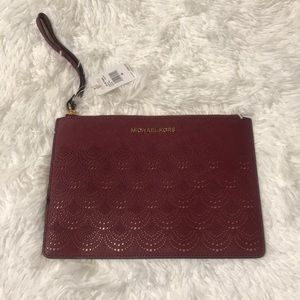 Brand New Burgundy and gold MK wristlet